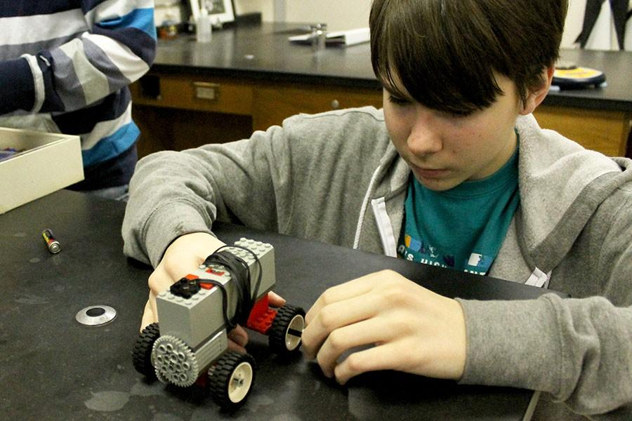 Sophomore Dawson Rooney works on his electric car for Science Olympiad.