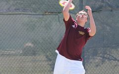 Boys tennis competes at home