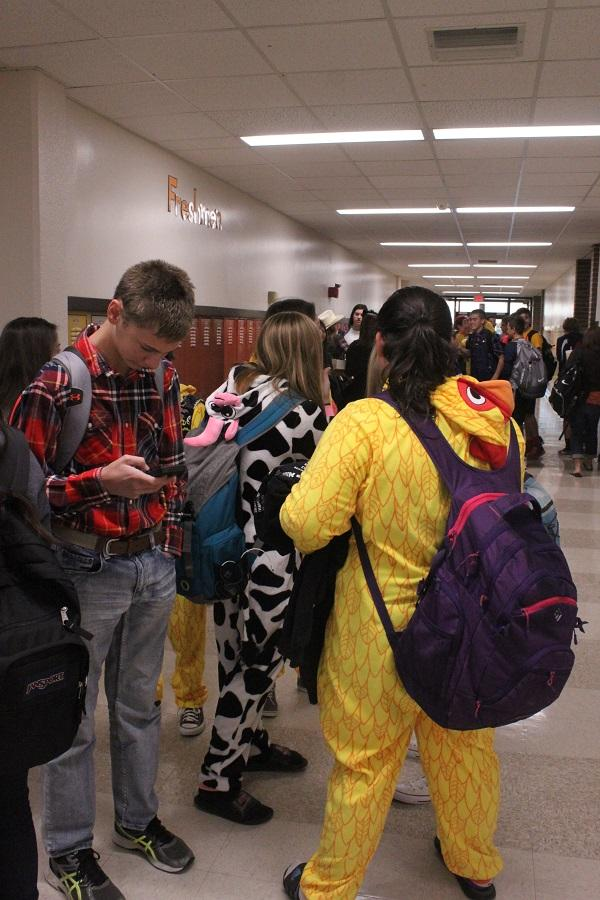 Students gather in the freshman hallway before school on Barnyard Buds day.
