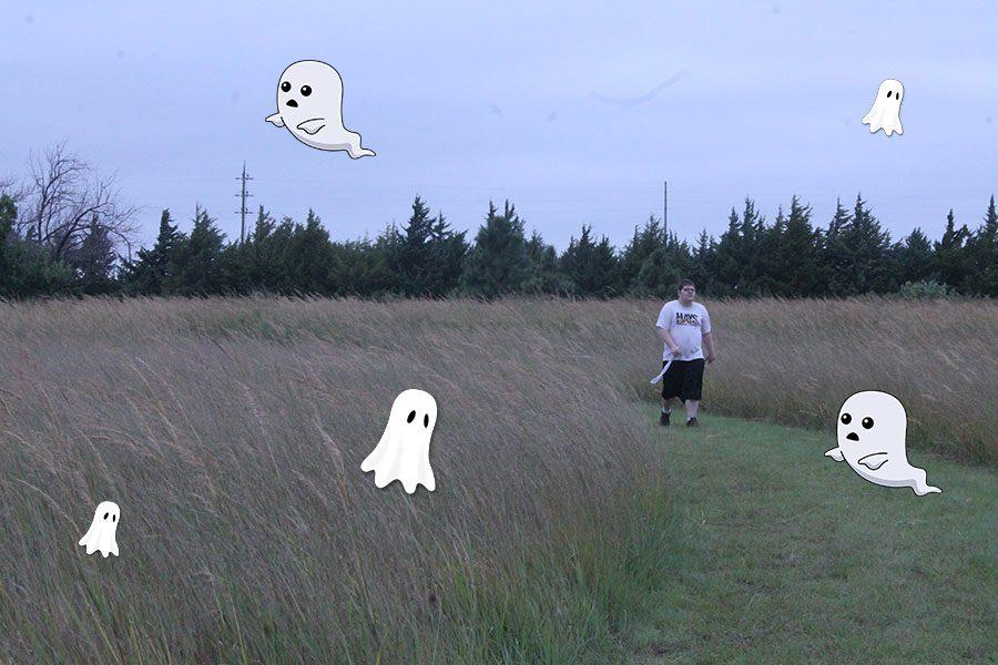 Senior John Legleiter walks in the outdoor classroom in PE when, suddenly, spookies pop out.