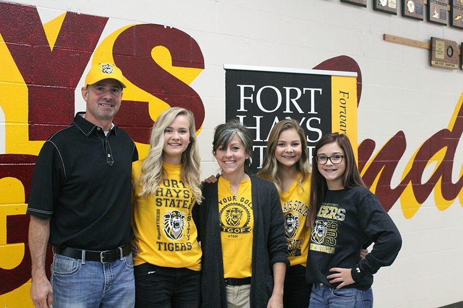 Senior Katie Brungardt poses with family after signing ceremony.