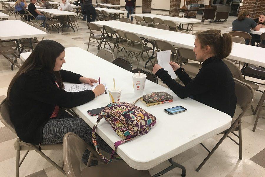 Seniors Sierra Eichman and Jeanie Balzer participate in Kids Vote Kansas.