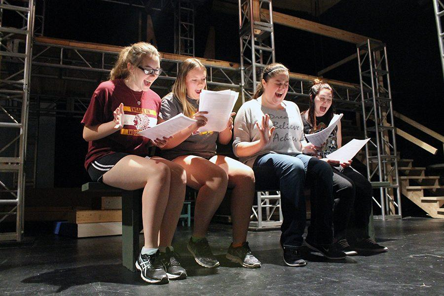 Juniors Taya Randle, Shelby Knoll, Emily Ricke and senior Jordyn Dake rehearse an energetic scene.