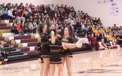 Varsity cheerleaders perform new routine at pep assembly