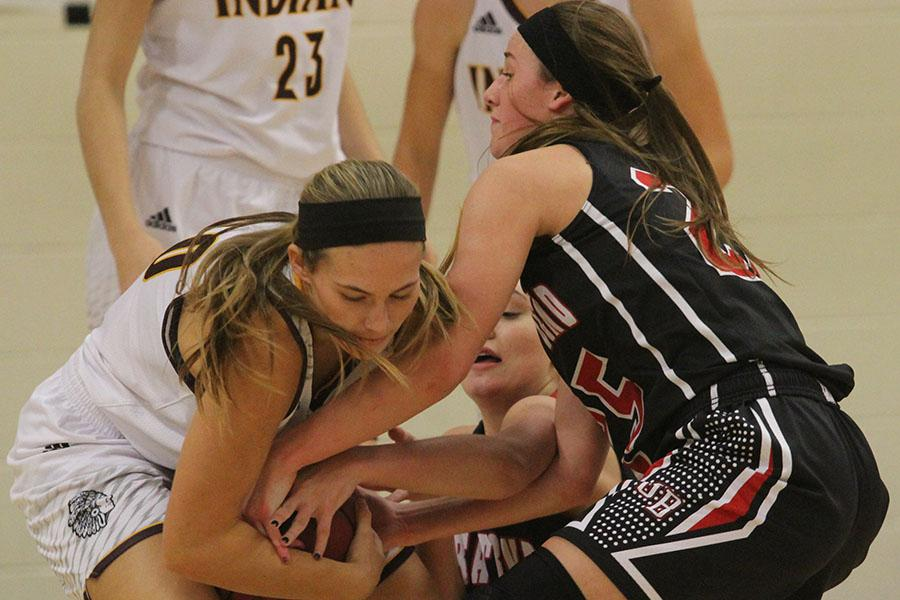Junior Macey Steckel fights a player from the Great Bend Panthers for the ball during a recent game at the Hays City Shootout. On Dec. 6, Lady Indians faced the Greenbacks and came away with a 53-33 victory.
