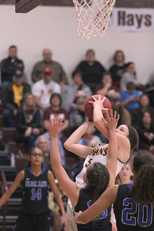 Sophomore+Jaycee+Dales+goes+up+for+a+shot+on+Dec.+13+against+the+Junction+City+Blue+Jays.+Dale+had+13+points+on+the+night.+