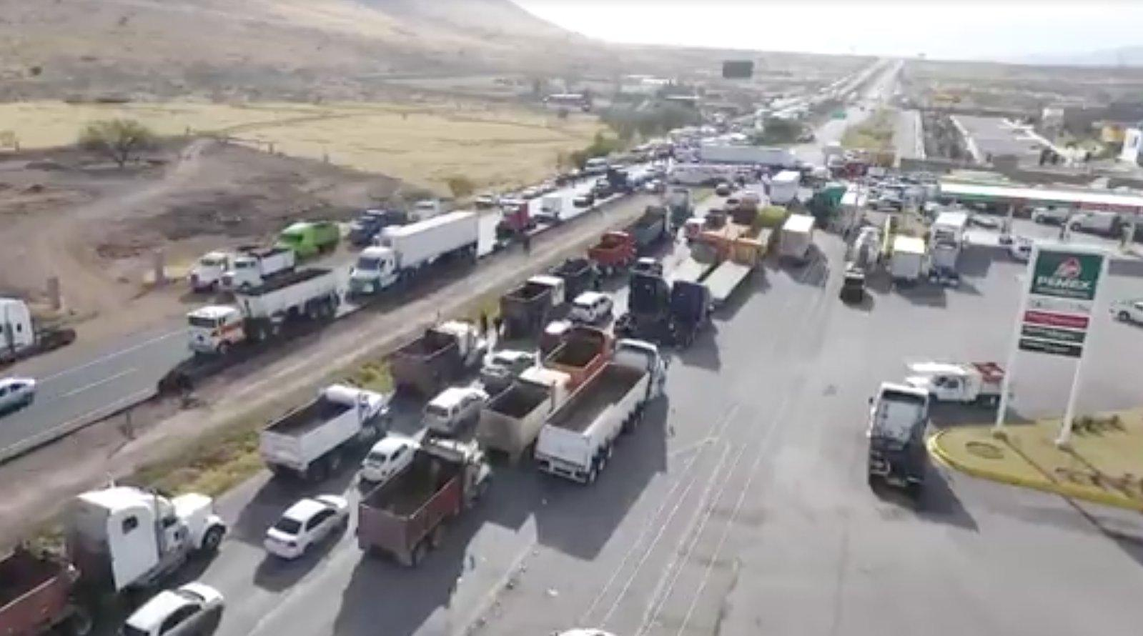 Traffic is stalled on a highway in Chihuahua due to a blockade put in place to protest raised gas prices.