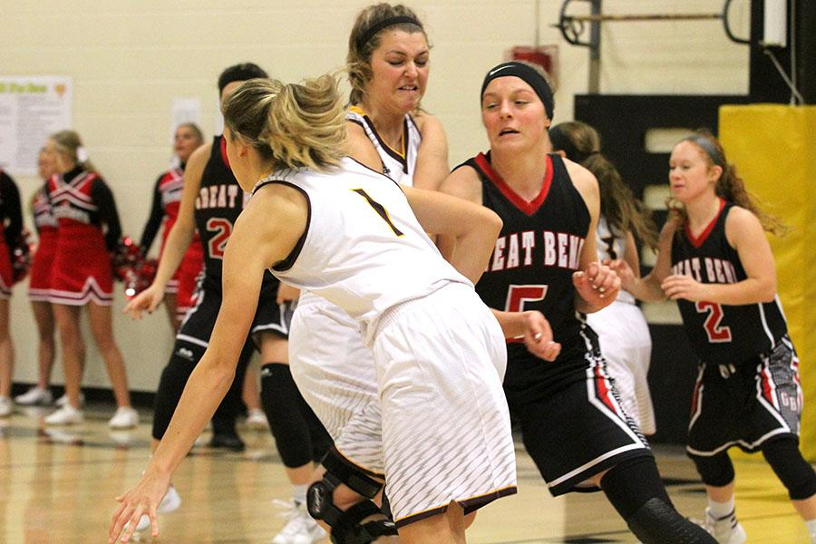 Senior Talyn Kleweno dribbles around a screen set by senior Maddie Keller during the game against the Great Bend Panthers during the Hays City Shootout in December. The Indians fell to the Great Bend Panthers on Jan. 10.
