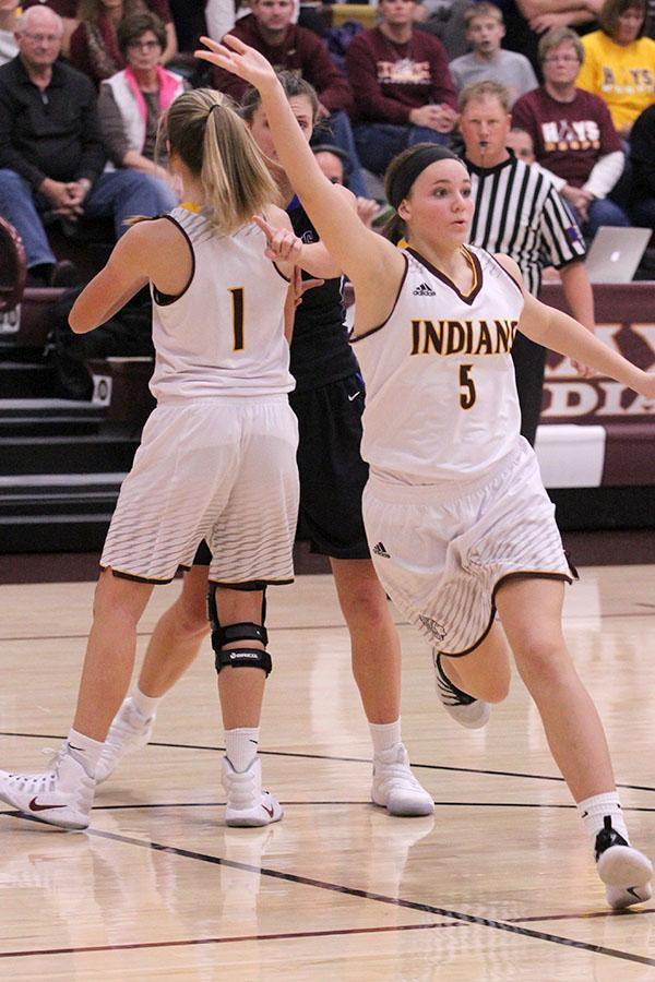 Sophomore Jaycee Dale calls for the ball in a recent game against the Junction City Blue Jays. On Jan. 31, the Indians defeated the Salina South Cougars.