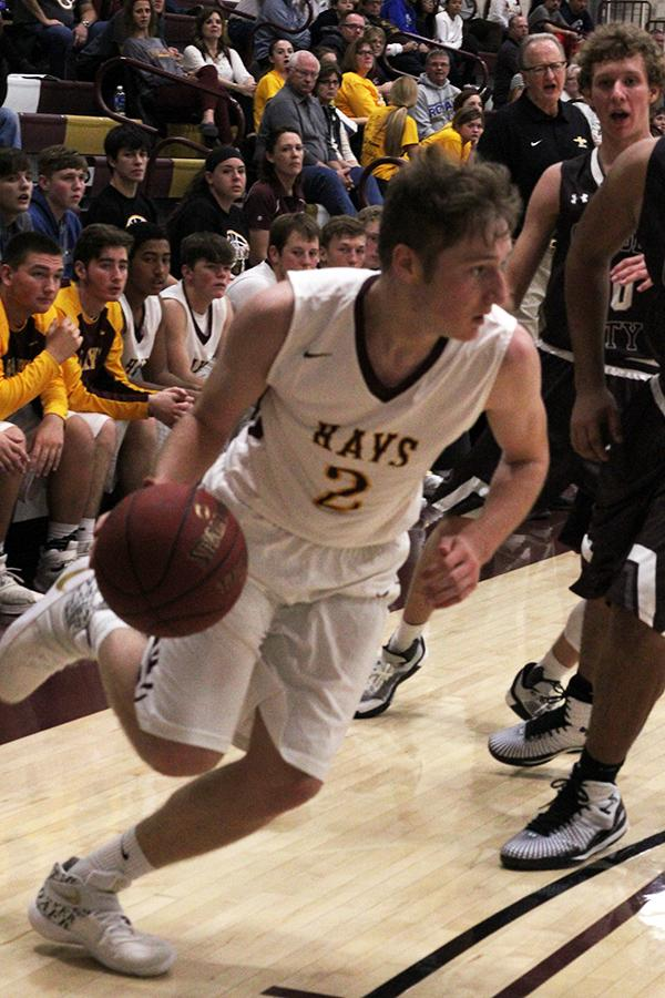 Junior Cole Murphy drives the baseline to the basket in a recent home game.