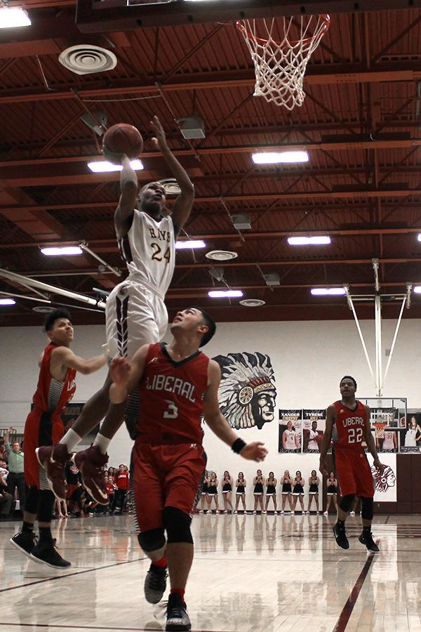Senior Claiborne Kyles pulls up for floater  against Liberal player during game on Feb. 10.