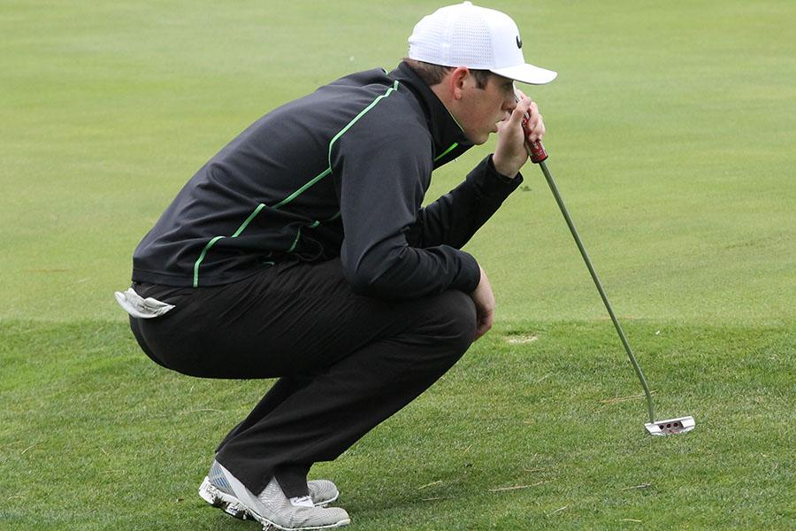 Senior Peyton Kieffer lines up the ball at the Hays Invitational last year.