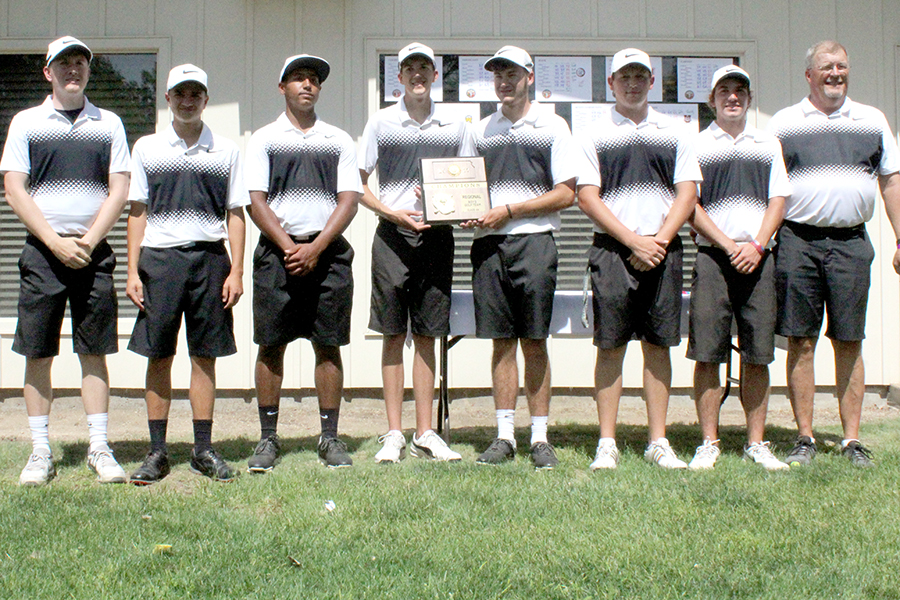 Members of the boys golf team display their regional championship trophy at Smoky Hill Country Club on May 15.