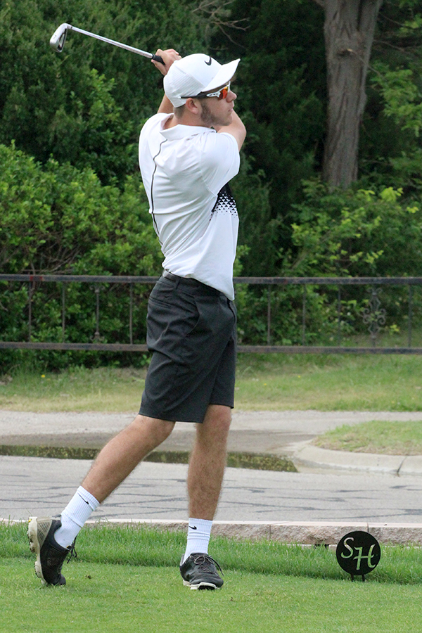 Senior Justin McCullick tees off at the Class 4A Regional Golf Tournament in Hays. McCullick finished with a 17th-place medal at the state tournament on May 22.