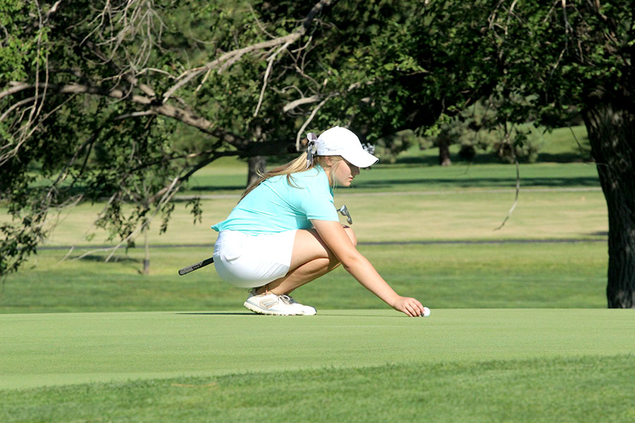 Junior+Brittani+Park+lines+up+on+the+green+at+the+Lady+Indians+season+opener+at+home.+