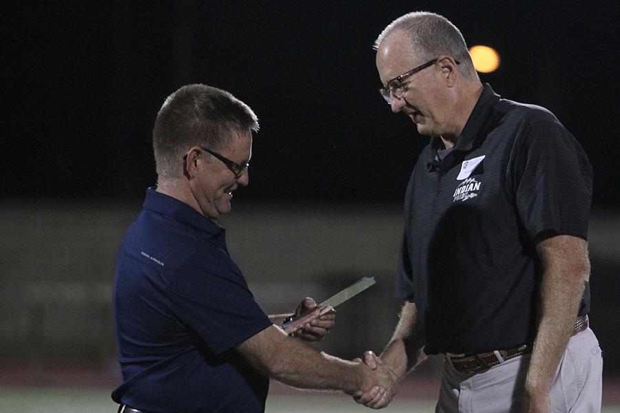 Rick Keltner accepted his KCCTFCA award at the home game against Garden City. Photo by Hannah Harman.