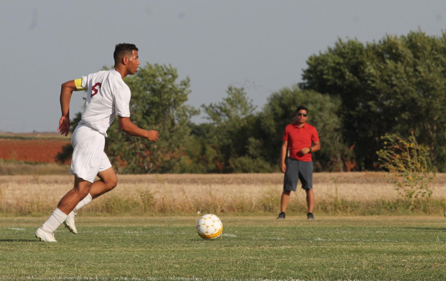Senior Ethan Nunnery looks to attack the defense in a recent home game against Great Bend.