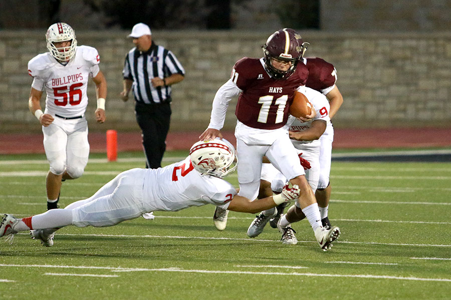 Senior Hunter Brown runs past a defender on Oct. 13 against the McPherson Bullpups. The Indians lost 48-6.
