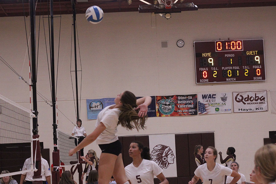 Junior Jaycee Dale goes for a kill at a home for the Hays Quad
