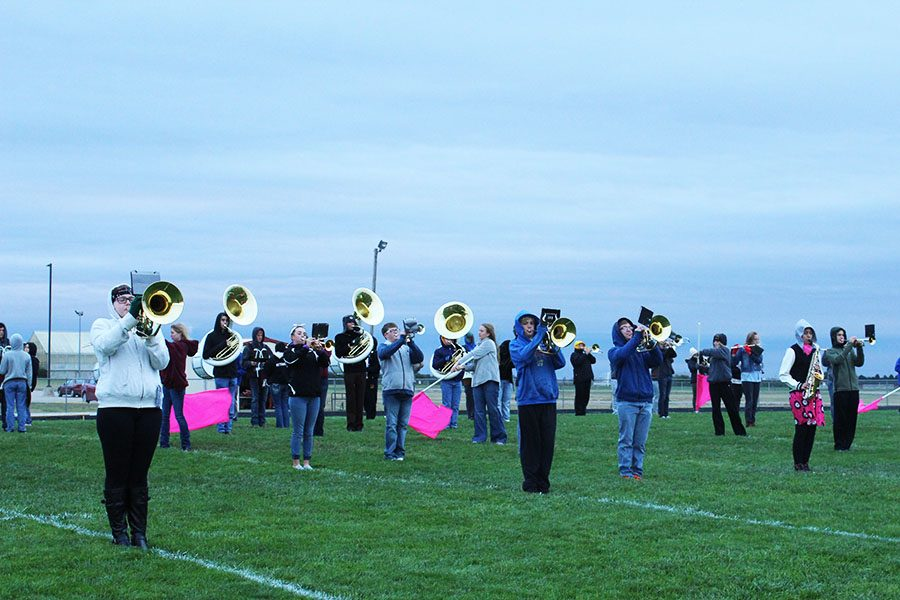Students+in+marching+band+practice+their+show.+