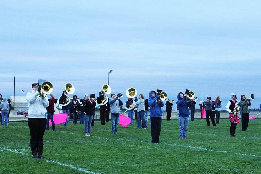 Students in marching band practice their show.