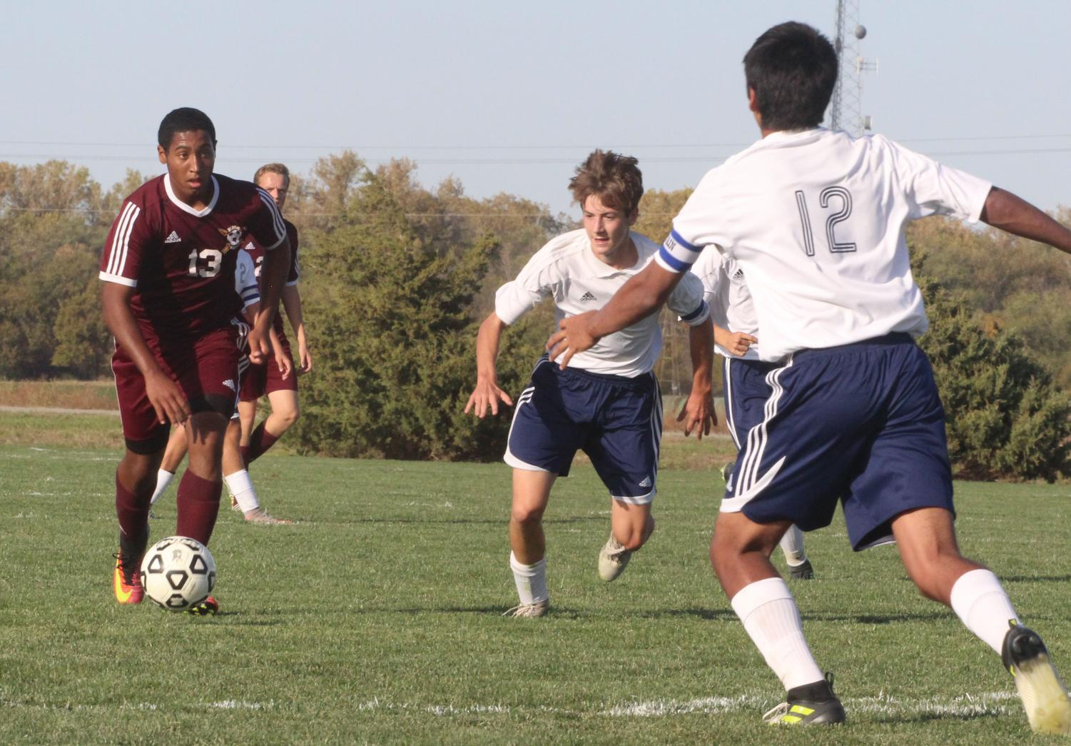 Junior Trey McCrae dribbles at the TMP defense in a recent cross town rivalry match up, where the Indians won 7-2.