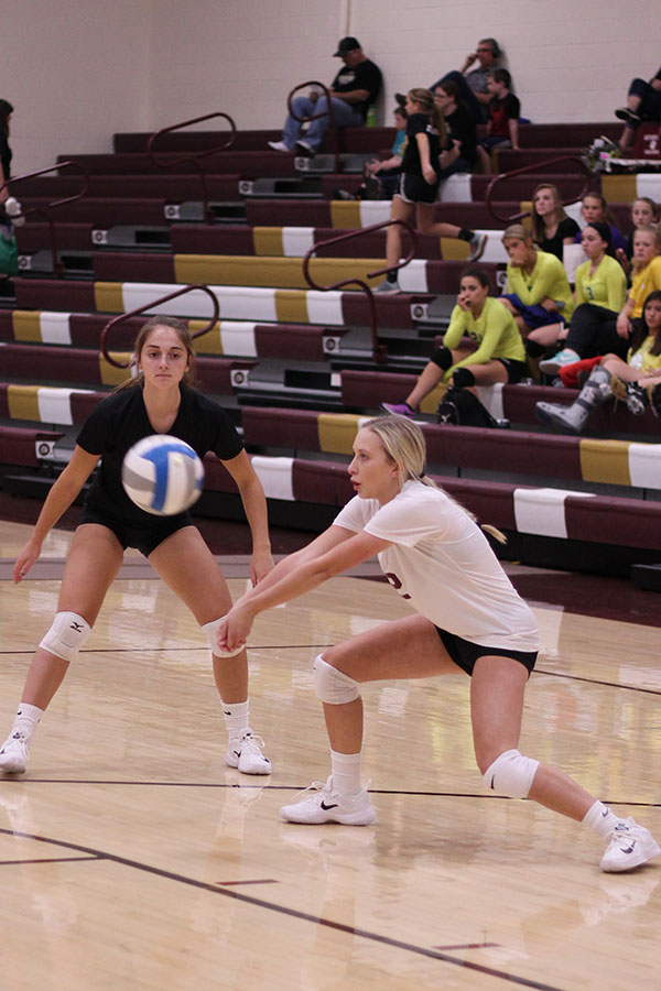 Freshman Brookyn Schaffer digs the ball at home vs Salina South last year.