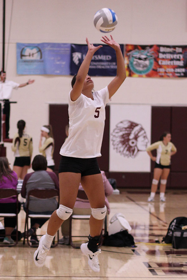 Junior Tasiah Nunnery setting the ball last year at home. T. Nunnery led the team in kills in the season opener.