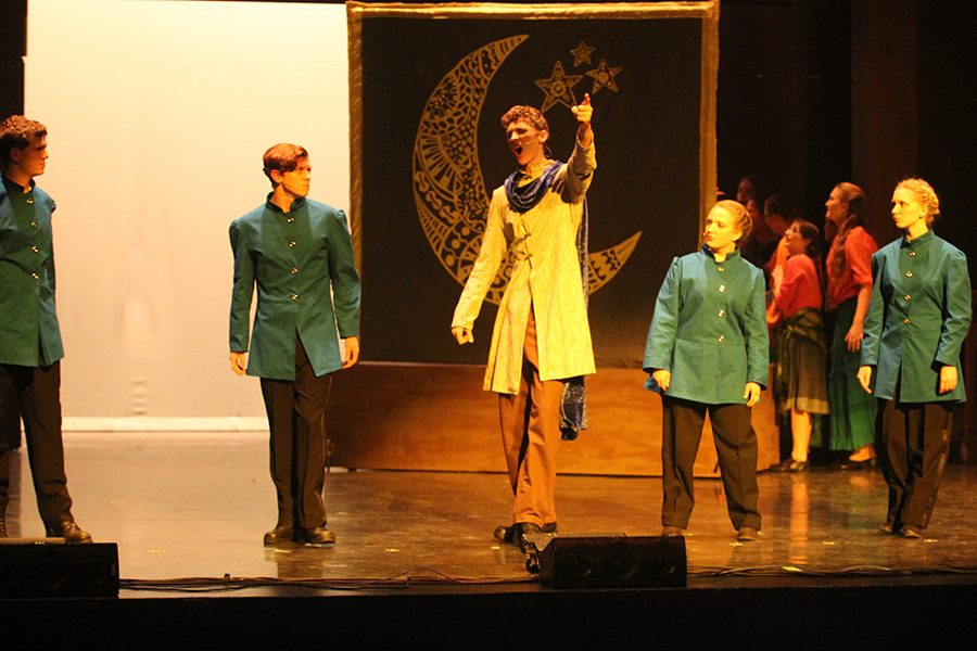 Captain Phoebus de Martin (junior Cade Swain) enters the scene and tells of his time on the front lines during the war. He is joined by four members of the cathedral guard (sophomore Nathan Leiker, junior Garrett Cole, senior Kyra Polifka-Wilhelm, and junior Rebecca Anderson) who help him tell his tale (