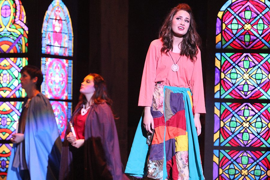 Gypsy Esmeralda (senior Erin Muirhead) sings in the Cathedral asking for God to help the outcasts (