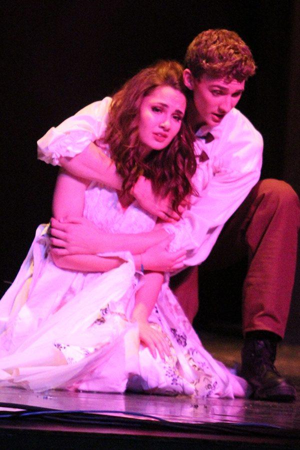 Captain Phoebus de Martin and Esmeralda (junior Cade Swain and senior Erin Muirhead) sing of their love and how