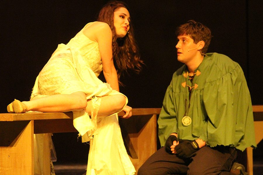 Esmeralda and Quasimodo (seniors Erin Muirhead and Ryan Will) sit at the top of the bell tower as Esmeralda is dying (