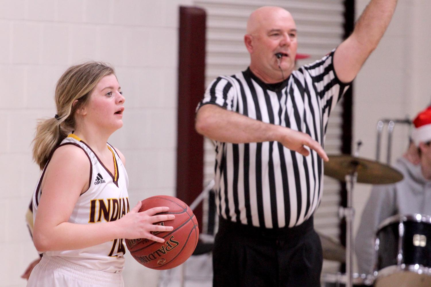 Junior Mattie Hutchison looks for an open player to throw the ball in bound to in a recent game against the Colby Eagles. The Lady Indians beat the Eagles 44-19.