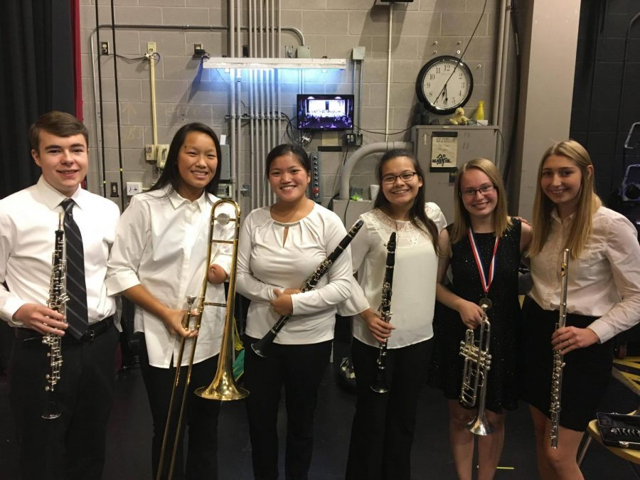 Hays students who qualified for KMEA district band pose for photo at the concert.