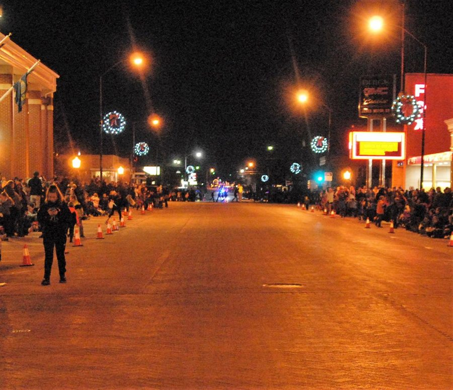 Community+members+gather+in+the+cold+to+watch+the+illuminated+Christmas+parade.