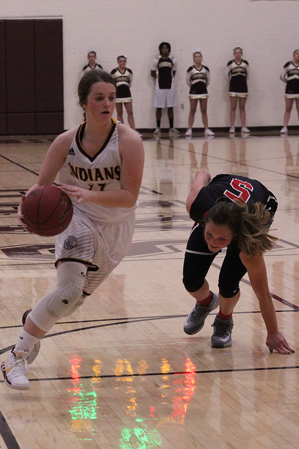 Sophomore Brooke Denning fakes out Liberal defender and drives to the hole for an easy lay up in a recent home match up at home.