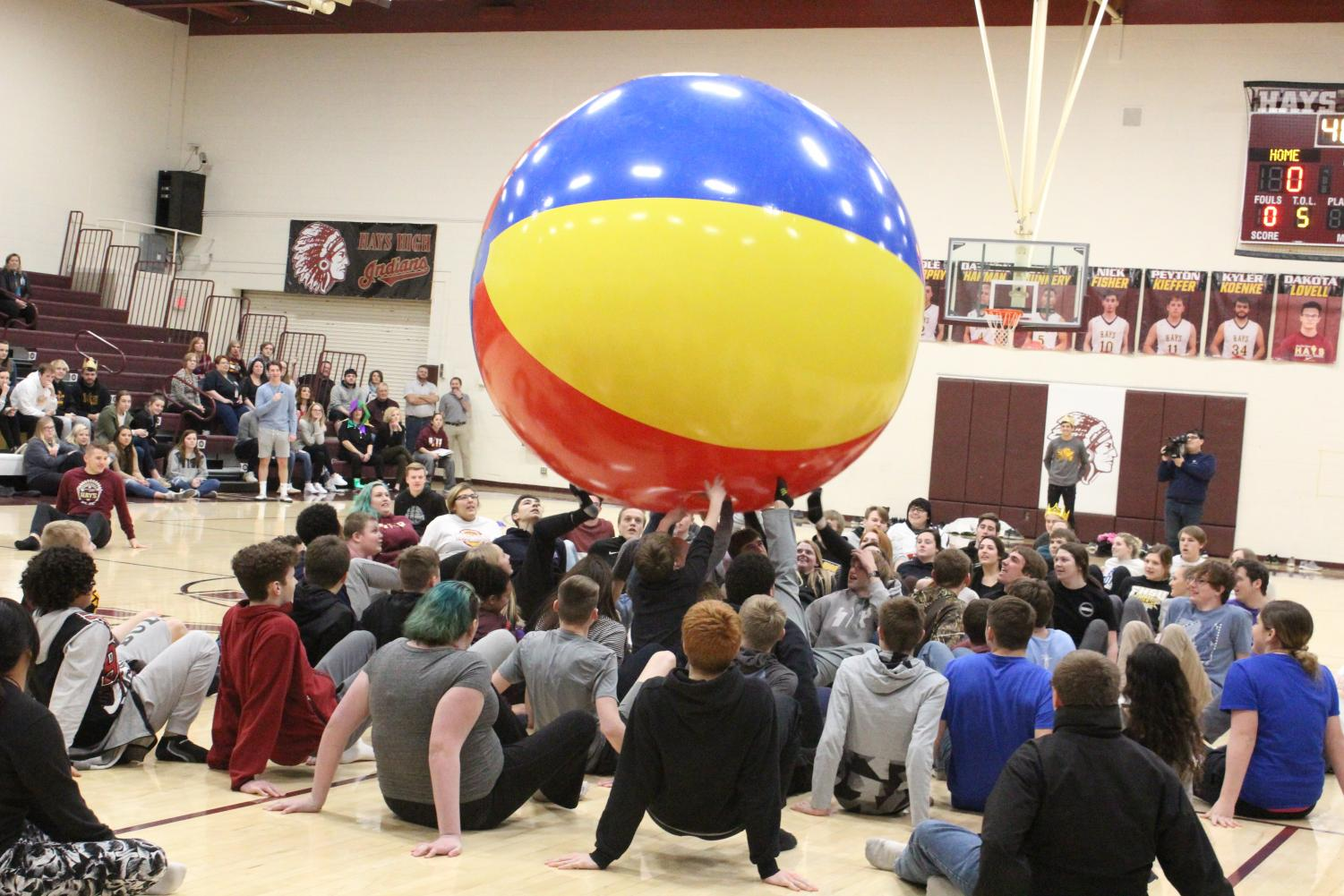 Freshmen compete against seniors in the beach ball competition.  Each class was trying to kick the ball over the other team's free throw line.