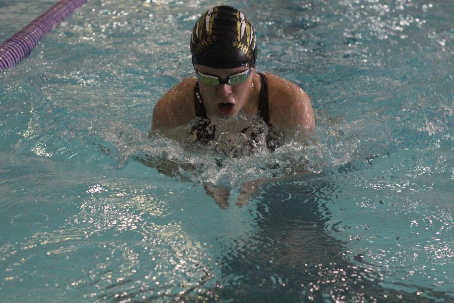 Sophomore+Megan+Flavin+swimming+the+breastroke+during+her+200+IM.+She+placed+4th+overall.