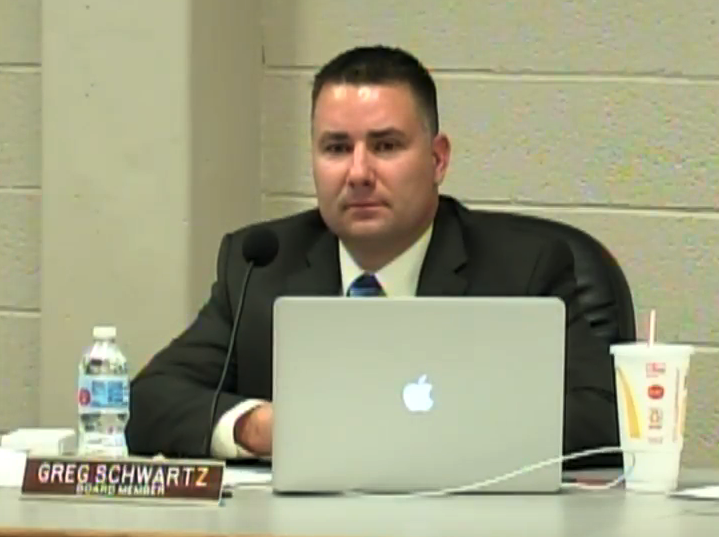 Board member Greg Schwartz debates the technology proposal at the board meeting. The meeting was held on April 30. The board voted 5-2 to pass the Dell Latitude proposal. Schwartz along with board member Lance Bickle voted against the proposal.