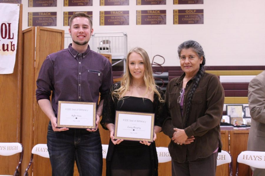 Seniors Kyler Voss and Lacey Gregory received the KSDE Seal of Biliteracy. They were recognized for having attained proficiency in English and one or more other language by the time they graduate.