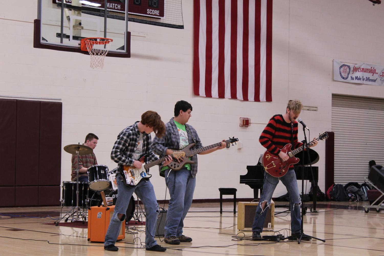 Juniors Calvin Duden, Garrett Cole, Jackson Stanton and Spencer Wittkorn perform an original song.