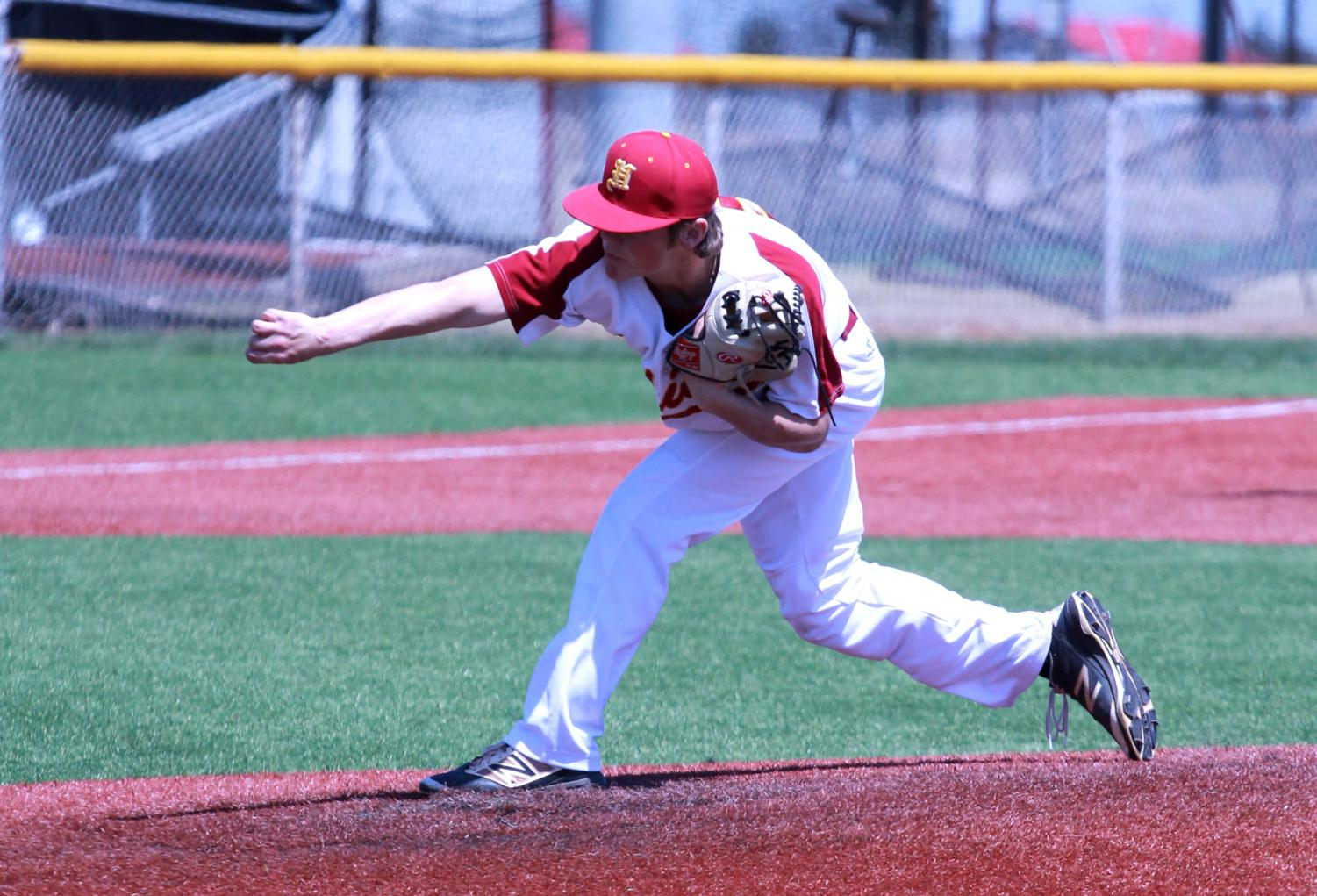 Senior Willie Sennett pitches in a home game last year.