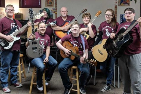 Rather than having one guitar club group it was split into two-- advanced and beginner.