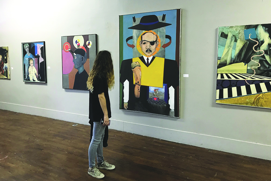 Senior Cydney Howell visits the Hays Arts Council with her Painting class.