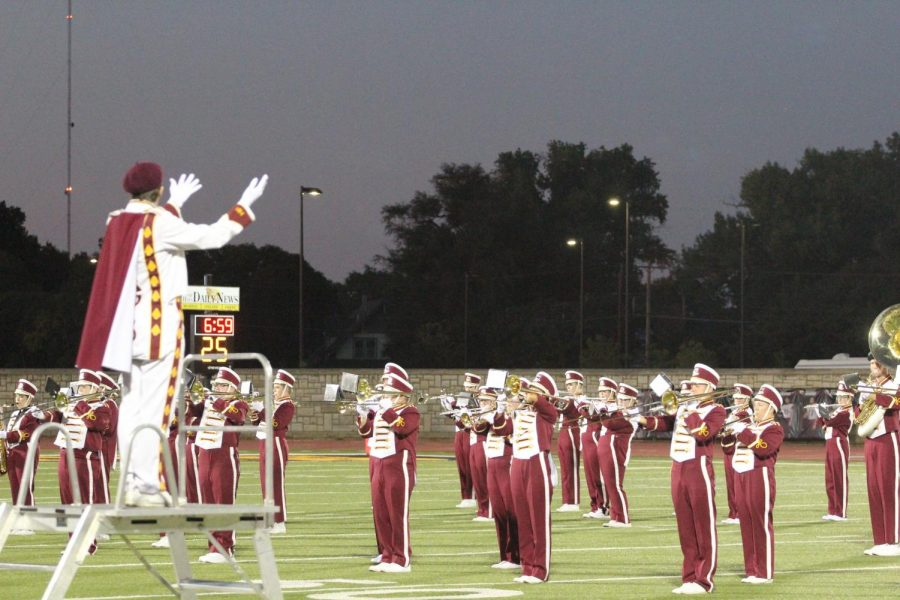 The Marching Indians perform their halftime show at a home football game against Liberal.