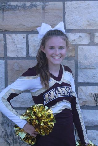 Freshman Landri Dotts poses for her cheer picture at Maroon and Gold. Dotts is involved in both cheer and cross country.