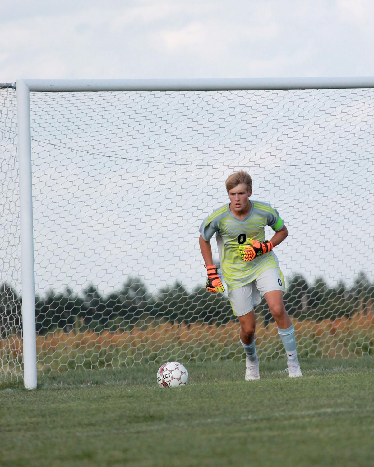 Senior Connor Teget runs up for a goal kick in in the minutes leading up to a lightning delay. The game resulted in a 2-1 loss for the Indians .