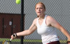Girl tennis places first at first varsity meet