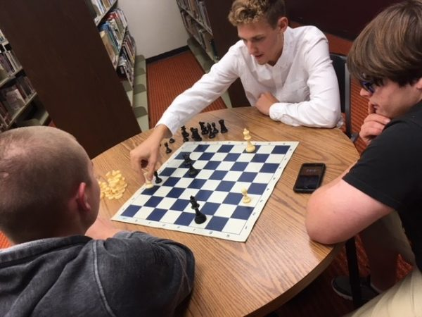 Seniors Cade Swayne and Spencer Wittkorn play a game of chess during a Chess Club meeting.