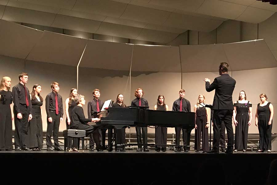 Vocal director Alex Underwood conducting Chamber Singers during the Fall Concert